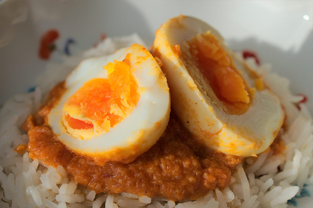 Sambal goreng telor. Indonesian spicy eggs .